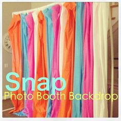 Brilliant - plastic tablecloths as photo booth backdrop!