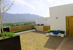 Hogar OV. : Terrazas de estilo translation missing: mx.style.terrazas.moderno por Lozano Arquitectos