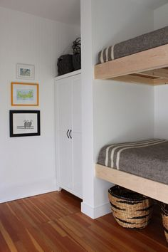 Consider building out a bit of wall to nestle bunk beds in against 3 walls. simple gray and stipe boy bedding, built in bunks. Bunk Beds For Girls Room, Bunk Bed Rooms, Bunk Beds Built In, Modern Bunk Beds, Cool Bunk Beds, Bunk Beds With Stairs, Kid Beds, Building Bunk Beds, Bunk Bed Wall