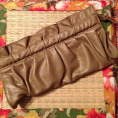Express Clutch: Metallic Gold Hot metallic gold clutch from Express, never used! Spacious inside, secure zipper, fabulous for a casual day on the town or a glitzy night out.       20% off all bundles!!! Express Bags Clutches & Wristlets