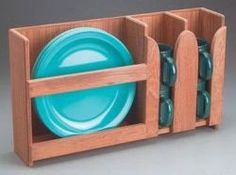 Neat little dish storage idea! Alter slightly by removing the mug section and putting a smaller section similar to the plate area there for bowls/bread plates. Hang mugs on cup hooks underneath.