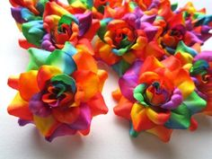These silk flowers are a better deal! These might be good for hair pieces or boutonnieres.