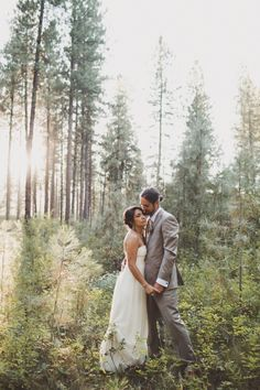 Gorgeous whimsical bride and groom portrait in the forest, so romantic
