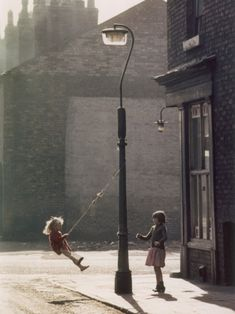 shirley baker, two girls swing on a lampost, manchester, 1965 » for the black and white version, pls see my previous post here