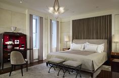 Hot Trends for Adding Art Deco into your Interiors - an essential part of the Art Deco style was evoking drama and grandeur of the silver screen. Neutral color palettes combined with shiny fabrics, subdued lighting and an abundance of soft materials along with fabrics hung behind master bedroom beds were indicative of this lavish and luxurious style.