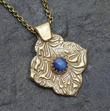 Metal Jewelry This unique necklace features a beautiful lab created star sapphire… - Star sapphire and gold metal clay necklace with mehndi quatrefoil design, unique art jewelry Metal Clay Jewelry, Jewelry Art, Fine Jewelry, Fashion Jewelry, Unique Jewelry, Unique Art, Jewelry Making, Jewelry Bracelets, Vintage Jewelry