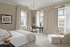 Bedroom of our luxurious Premier Suite in Neo -Classical building at Four Seasons Hotel Prague.