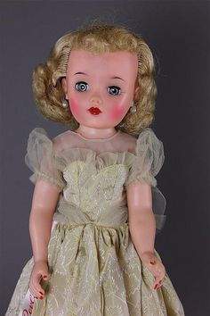 """18"""" IDEAL MISS REVLON IN TAGGED YELLOW BROCADE DRE - by Apple Tree Auction Center"""