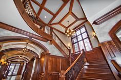 (Open Staircase, wooden banister, wood theme carried throughout house) Wooden staircase with wrought iron
