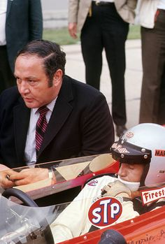 1969 Indy 500 Qualification Auto Racing: Indianapolis 500 Qualifying: Mario Andretti (R) talking to owner Andy Granatelli during time trials at Indianapolis Motor Speedway. Indianapolis, IN 5/17/1969 CREDIT: Neil Leifer (Photo by Neil Leifer /Sports Illustrated via Getty Images) (Set Number: X14075 TK2 R1 F7 ) Indy Car Racing, Indy Cars, Neil Leifer, Mario Andretti, Indianapolis Motor Speedway, Ferrari, Four Wheel Drive, Automotive Art, Sports Illustrated
