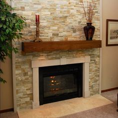 Loved the chipped stone tile for this fireplace surround