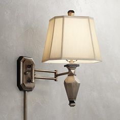 the heavily brushed champagne finish of this swing arm wall lamp offers intriguing visual allure to
