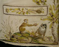 Detail, Man's Waistcoat, France, 1780-89, silk & linen. Two playful monkeys gather fruit from a palm tree beneath the pocket of this 1780s waistcoat. They are embroidered in coloured silks on an ivory ribbed silk. The design for this image, known as Les Macaques can be found in a pattern book of embroidery designs for waistcoats in the Musée Historique des Tissus, in Lyon, France, executed in watercolours.