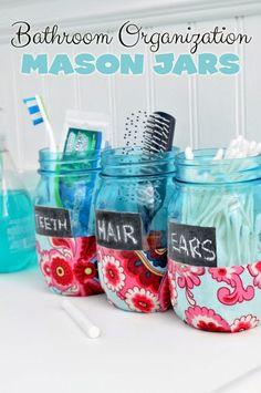 Bathroom Organization Mason Jars  - use chalkboard glass paint, fabric decoupage and pretty blue tinted mason jars to make this cute home decor craft idea!