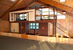 A spectacular indoor riding arena with a gorgeous viewing area & high ceilings for natural light.