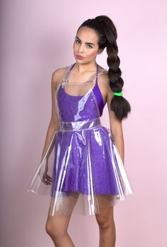 Are you ready to make a statement in this dress?  Super awesome fabric! Hologram glitter shines perfect in the light  Adjustable strap length  Zipper