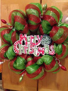Red and green merry Christmas decomesh wreath with glittery lightbulbs! Follow me on Instagram @michelleajo