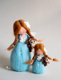 Little fairy girl, dressed in light blue, with her favorite teddy bear.