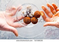 chocolate candy in hand on the transparent plate
