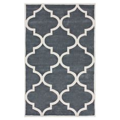 Hand-tufted rug with a Moroccan trellis motif.  Product: RugConstruction Material: 100% PolyesterCol...