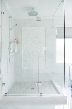 """Creekside Tile: shower walls are porcelain marble 12x24 in Verona Calacatta, shower base is moonstone polished, backsplash and shower inset are 1"""" hexagon in Calacatta, basket weave on main floor is Oriental white and moonstone, and pencil trim is Calacatta"""