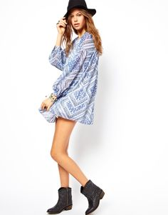 Cute boho smock paired with a wide brim and biker boots.