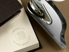 Add a touch of personal class to your collection of books by embossing them with a customized handheld Personal Library Book Embosser.