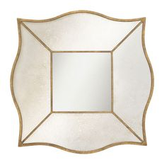 Distressed wall mirror with a quatrefoil design and antiqued gold leaf trim.              Product: MirrorConstruc...