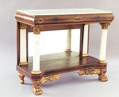 A Fine American Classical Carved and Gilt-Stenciled Mahogany and Mahogany and Marble Pier Table, c. 1830, New York.