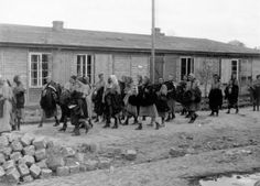Birkenau, Poland, Women pronounced fit for labor, after being processed, 05/1944.