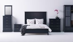 UNDREDAL black bed, chest of drawers, wardrobe and bedside table.