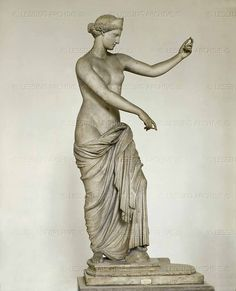 Goddess Aphrodite. Marble figure (1st CE) found at Capua, Italy. Roman copy of a 4th BCE Greek original.  Museo Archeologico Nazionale, Naples, Italy