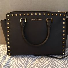 Michael kors selma studded This bag comes in mint condition. The only scratches it have is at the bottom golden part that is absolutely not noticable. It comes in a very rare chocolate color. Michael Kors Bags Crossbody Bags