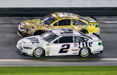Brad Keselowski and Kyle Busch race down the front stretch. Nascar Sprint Cup, Nascar Racing, Daytona 500, Daytona Beach, Michael Waltrip, Kyle Larson, Brad Keselowski, Daytona International Speedway, Kyle Busch
