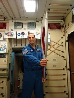 """AstroRM: """"In the ISS mockup with a replica of the Sochi Olympic torch."""""""