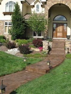 Stamped concrete and stained concrete entryway in Littleton, Colorado. Miracote Mirastamp with stain colors Beech Tree and gray highlights.