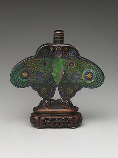 Snuff Bottle-19th century Culture: China Medium: Metal covered with lacquer and inlaid with mother-of-pearl and gold, wood stand