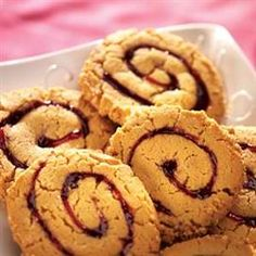 Peanut Butter and Jam Pinwheels  Serving Size (1 cookie), Calories 100 (Calories from Fat 40), Total Fat 4.5g (Saturated Fat 1g, Trans Fat 0g), Cholesterol 5mg, Sodium 55mg, Total Carbohydrate 12g (Dietary Fiber 0g, Sugars 6g), Protein 2g; Percent Daily Value*: Vitamin A 2%, Vitamin C 0%, Calcium 0%, Iron 2%.