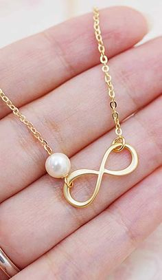Infinity charm with Swarovski Pearl Necklace from EarringsNation