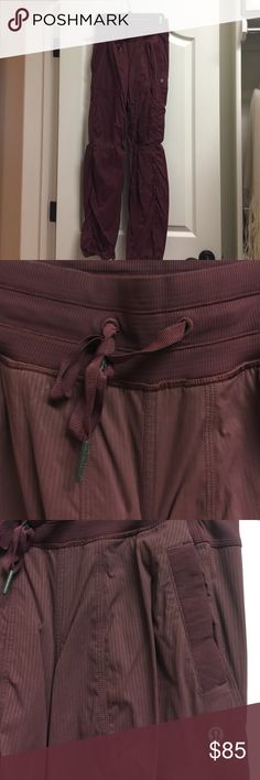 Lululemon BUrgundy Pant yoga pant in burgundy, lululemon size 2 (size 0 in standard sizing). Never been altered, worn once! lululemon athletica Pants Track Pants & Joggers