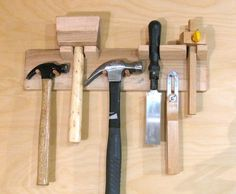 Nice and compact way to store tools! Alternate their mountings to fit more on the wall. {Tool holders}