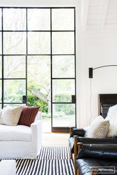 Gorgeous, right? Like an inky liquid eyeliner, black windows instantly transform a home from fresh faced school girl into hyper-cool Parisian ingenue. Black is the new black. The iron paned window is less a throwback to industrial chic and more a classic architectural convention that has never left the party. Here is some cold, hard evidence should you require convincing... - Anne Key Image Via Houzz
