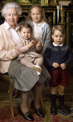 Who designed Prince George and Princess Charlotte's royal birthday portrait outfits?
