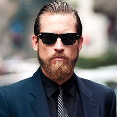Long Slicked Back Hair with Thick Beard