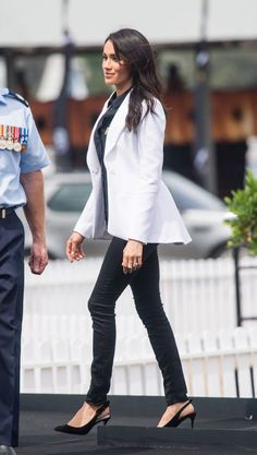267649e14e1 Meghan Markle Departs Australia In The Most Elegant Midi Dress