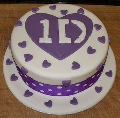 one direction logo cake by Paramount Cakes, via Flickr