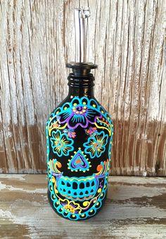 Botella del dispensador de calavera de azúcar colorida y