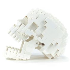 This anatomically correct human LEGO skull  by Felix Jaensch has an articulating lower jaw & even includes one interchangeable gold tooth.