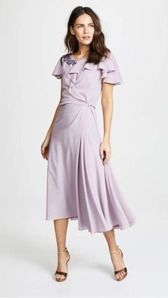 Zac Posen Ruffle Sleeve Dress. This minimalist Zac Posen dress has a pretty little detail on the shoulder to keep it fresh but still simple. This one will easily become your favorite desk-to-date-night piece. #cutedress #romanticdress #romanticstyle #ruffles