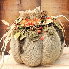 Off the page project for Oct is a paper mache pumpkin. I turned mine into a burlap and raffia harvest fest. This pumpkin is also loaded with fabulous new Prima Marketing Flowers and some new trim by Frank Garcia. Burlap Pumpkins, Fabric Pumpkins, Fall Pumpkins, Pumpkin Crafts, Fall Crafts, Holiday Crafts, Fall Halloween, Halloween Crafts, Halloween Patterns